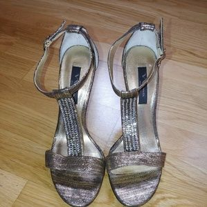 Nina gold heels with crystal details.